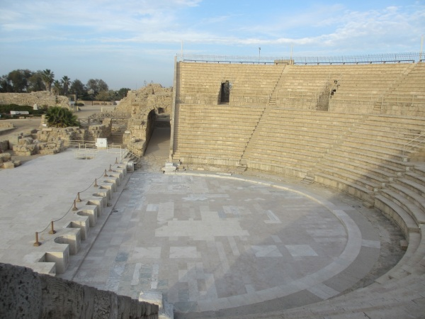 Interior of the amphitheater. In the garden (upper left), architectural fragments are displayed on pedestals.