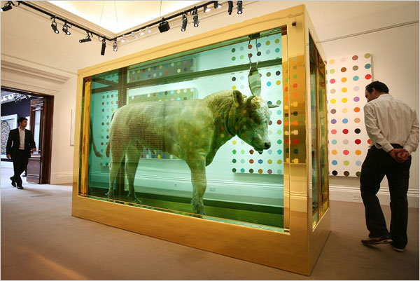 "Visitors encounter ""The Golden Calf"" by Damien Hirst, which at $18.6 million was the top seller of Sotheby's two-day sale. Peter Macdiarmid/Getty Images."
