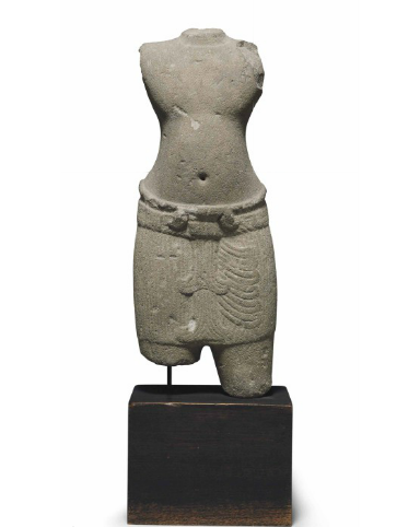 Lot 414. A sandstone male torso Khmer, Angkor period, Pre-Rup style, 10th century, 15 in. (38 cm.) high  Estimate: $8,000-12,000 Provenance Private collection, New York, acquired in Bangkok, 4 December 1973
