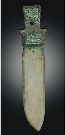 Lot 1125. A RARE TURQUOISE-INLAID BRONZE AND JADE GE HALBERD BLADE LATE SHANG DYNASTY, 13TH-11TH CENTURY BC 8½ in. (21.6 cm.) long Estimate: $20,000-30,000.