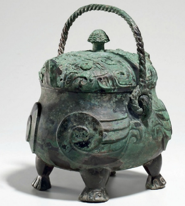 Lot 1220. A VERY RARE AND EXCEPTIONAL BRONZE RITUAL OWL-FORM WINE VESSEL, XIAO YOULATE SHANG DYNASTY, 12TH-11TH CENTURY BC  10 in. (25.5 cm.) high with handle, 8 in. (20.3 cm.) across, box  Provenance Private collection, Japan, prior to 1998. Galerie Christian Deydier, Paris. Estimate on request.
