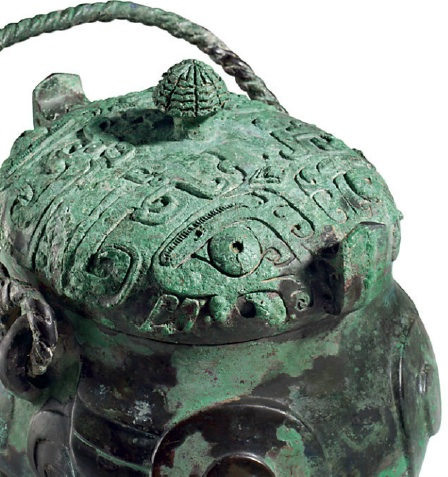 DETAIL - Lot 1220. A VERY RARE AND EXCEPTIONAL BRONZE RITUAL OWL-FORM WINE VESSEL, XIAO YOULATE SHANG DYNASTY, 12TH-11TH CENTURY BC 10 in. (25.5 cm.) high with handle, 8 in. (20.3 cm.) across, box Provenance Private collection, Japan, prior to 1998. Galerie Christian Deydier, Paris. Estimate on request.