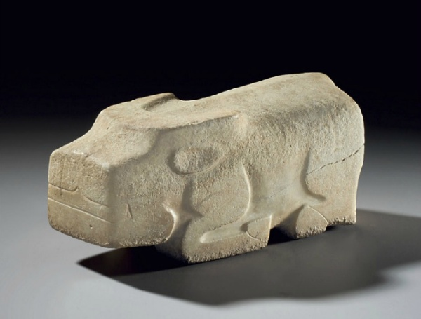 Lot 1258. A VERY RARE EARLY WHITE MARBLE FIGURE OF A RECUMBENT WATER BUFFALO LATE SHANG DYNASTY, 12TH-11TH CENTURY BC  10¾ in. (27.4 cm.) long  Provenance Robert H. Ellsworth, New York, 1997. Christie's New York, 17 September 2010, lot 1004.  Estimate: $80,000-120,000.