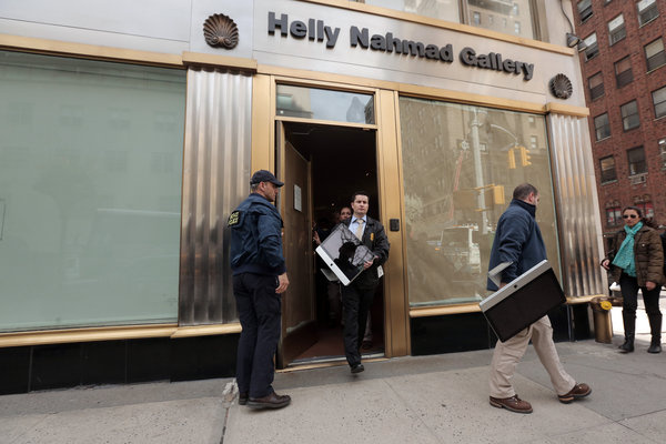 Federal agents removed computers from the Helly Nahmad Gallery located inside the Carlyle Hotel on Tuesday.
