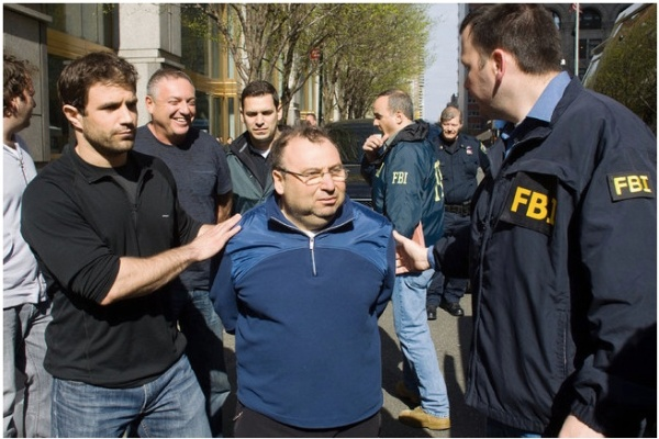 Two men arrested on Tuesday as part of the investigation were Anatoly Shteyngrob and, back, a smiling Anatoly Golubchik.
