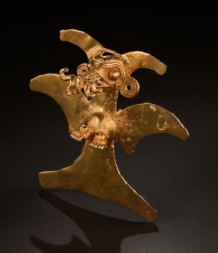 Lot 54316. A LARGE VERAGUAS GOLD PENDANT REPRESENTING AN EAGLE. c. 900 - 1200 AD Perhaps a harpy eagle with its wings extended and its feet posed as if for landing. The eagle carries a small animal in its beak. Weight: 109 grams. Height: 4 inches Estimate: $25,000 - $35,000.