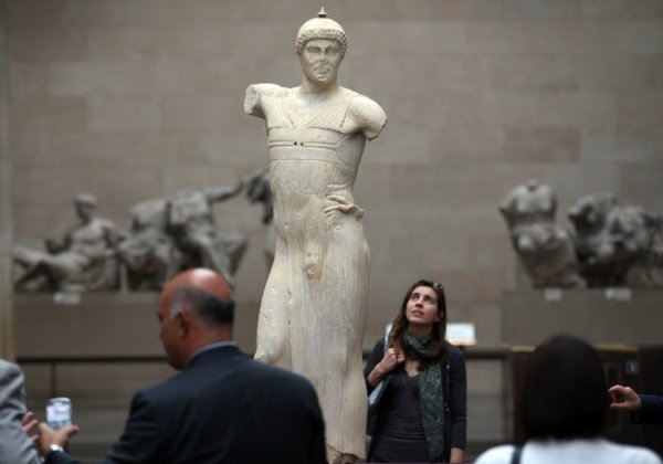 The statue of a charioteer, shown in London, is now on display at the Getty Villa.