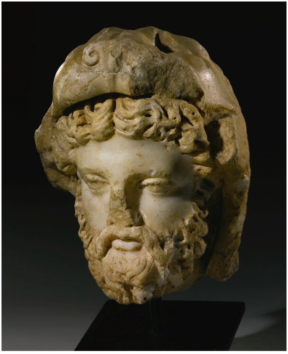 Lot 18. A MARBLE HEAD OF HERAKLES, ROMAN IMPERIAL, 2ND CENTURY A.D. perhaps a portrait of Emperor Commodus, turned to his right, with thick unruly hair and beard, long moustache, large eyes with indented pupils, and prominent brow, his head surmounted by the head of his lion skin. Height 9 1/2 in. 24.1 cm. Estimate: $60,000 - 90,000. Provenance Galerie Simone de Monbrison, rue Bonaparte, Paris French private collection, acquired from the above circa 1980 (Sotheby's, New York, June 7th, 2007, no. 67, illus.)