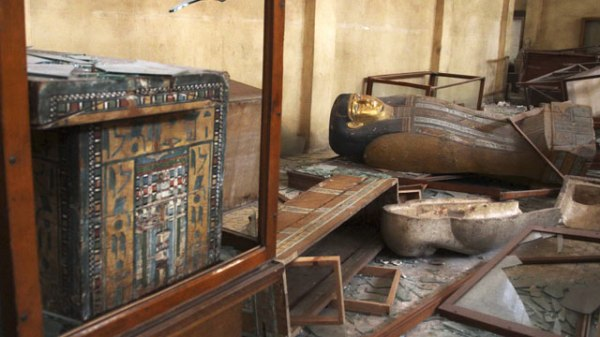Damaged pharaonic objects lie on the floor and in broken cases in the Malawi Antiquities Museum after it was ransacked and looted. (AP Photo/Roger Anis, El Shorouk Newspaper)