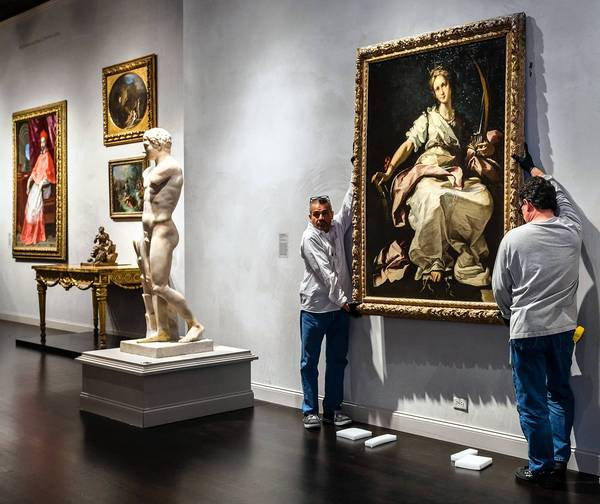 The life-size figure of St. Catherine of Alexandria, painted in Genoa around 1615 by Bernardo Strozzi, was installed Monday in the third floor galleries for European art at the Los Angeles County Museum of Art. (Los Angeles County Museum of Art / November 25, 2013)