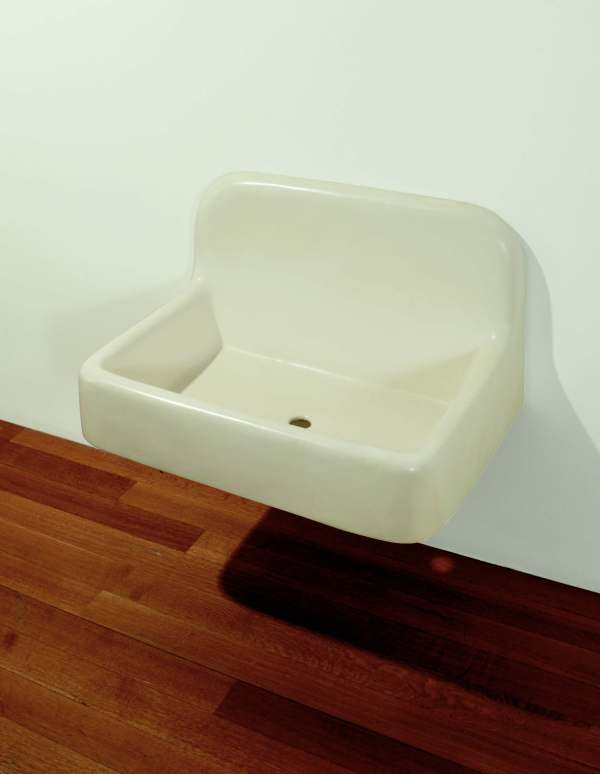 "Lot 19. Robert Gober (b. 1954)  The Silent Sink  signed, titled and dated 'R. Gober '84 ""The Silent Sink""' (on the reverse) plaster, wire lath, wood and semi-gloss enamel paint  20 x 35 x 27 in. (50.8 x 88.9 x 68.5 cm.)  Executed in 1984.  Estimate: $2-3 million. Click on image to enlarge."