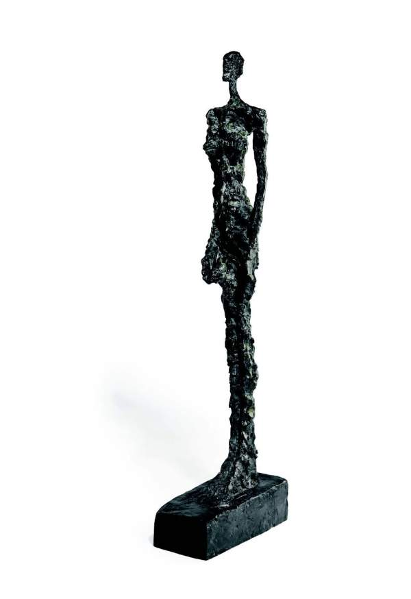 Lot 33. ALBERTO GIACOMETTI (1901-1966) Femme de Venise IV signed and numbered 'Alberto Giacometti 2/6' (on the left side of the base); inscribed with foundry mark 'Susse Fond. Paris' (on the back of the base) bronze with dark brown and green patina and hand-painted by the artist Height: 45Ω in. (115.5 cm.) Conceived in 1956 and cast in 1957 $10-18 million.
