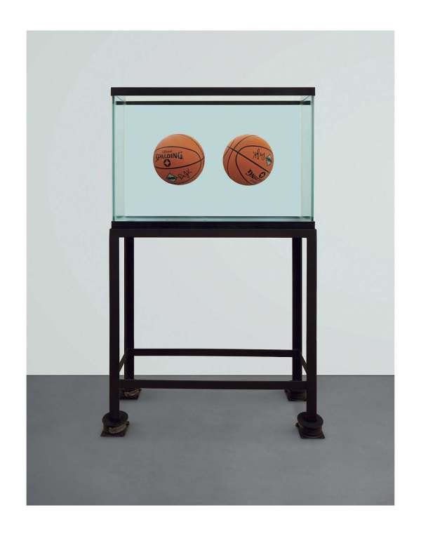 Lot 7. Jeff Koons (B. 1955)  Two Ball Total Equilibrium Tank (Spalding Dr. J Silver Series)  glass, steel, sodium chloride reagent, distilled water and two basketballs 62¾ x 36¾ x 13¼ in. (159.4 x 93.3 x 33.7 cm.)  Executed in 1985. This work is number two from an edition of two. Estimate: $4-6 million. Click on image to enlarge.