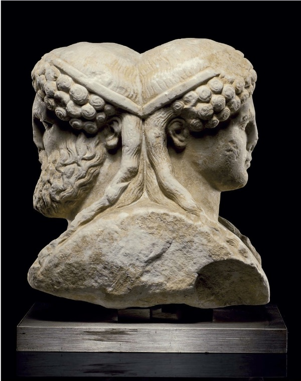 Lot 109. A ROMAN MARBLE JANIFORM HERM BUST  CIRCA 1ST CENTURY B.C.-1ST CENTURY A.D.  Archaistic in style, both depicting Hermes, one older, the other youthful, both with deeply-set heavy-lidded eyes and long hair bound in a fillet, the strands radiating from the crown and terminating in three rows of snail-curls above the forehead, with thick tendrils falling from behind the ears, along the neck and forward over the shoulders, the older with a full spade-shaped beard of wavy locks and a long downturned mustache framing full lips pressed together 13 in. (33 cm.) high  Estimate: $100,000-150,000. Click on image to enlarge. Provenance with Seibu Department Store, Tokyo, 1979 (Jean-Loup Despras, Hellénisme Gréce Rome et Gandhara, no. 5). Dr. Akira Hirabayashi, Tokyo, acquired from the above in 1979.