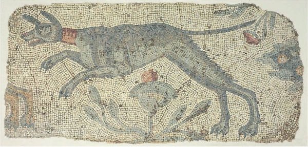 Lot 129. A LATE ROMAN MARBLE MOSAIC PANEL  CIRCA 4TH-5TH CENTURY A.D.  The multicolored composition on a cream ground, preserving a dog charging to the left, wearing a pink collar, pushing off his hind legs with the forelegs extended, his ears erect and curving forward, his long thin tail projecting behind, a plant with a pink flower below, additional foliage behind, the hind paws of a second animal preserved to the left 64 in. (162.6 cm.) x 30¼ in. (76.8 cm.)  Estimate: $8,000-12,000. Click on image to enlarge. Provenance with Galerie G. Maspero, Paris, 1989.