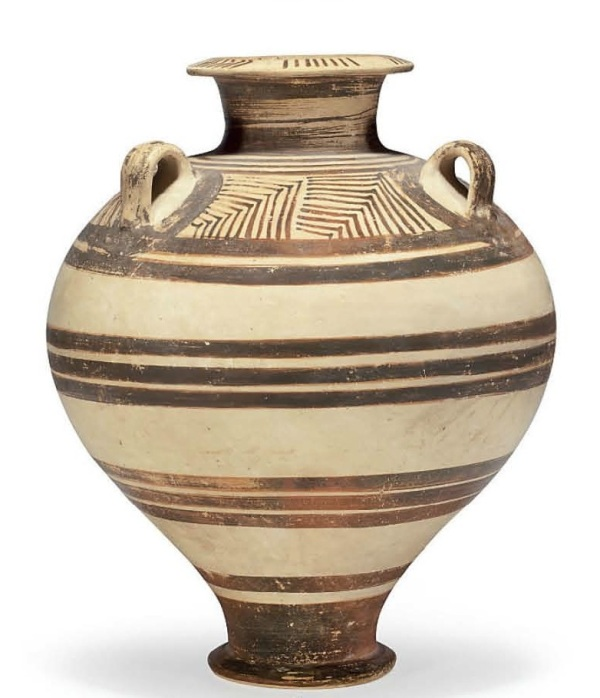 Lot 69. A MINOAN POTTERY JAR  LATE MINOAN III, CIRCA 1400-1300 B.C.  Of globular form tapering to the outsplayed foot, with a short cylindrical neck and overhanging disk rim, with three vertical loop handles on the shoulders, the body with a series of horizontal bands, the handle zone with sections of nesting chevrons graduated in size, the handles each encircled by a ring, chevron and lines on the mouth 16¾ in. (42.5 cm.) high  Estimate: $20,000-30,000. Provenance Antiquities, Sotheby's, London, 10 July 1990, lot 250.
