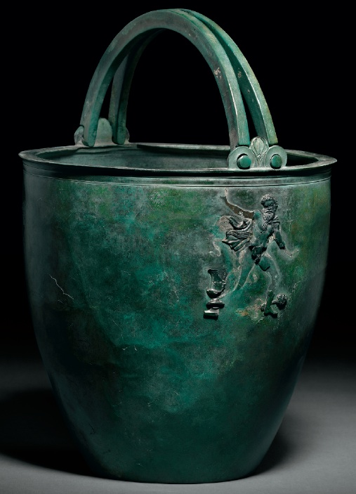 Lot 105. A GREEK BRONZE SITULA HELLENISTIC PERIOD, CIRCA LATE 4TH CENTURY B.C. 9 5/16 in. (23.6 cm.) high Estimate: $50,000-70,000 Provenance with Phoenix Ancient Art, Geneva, 1997.