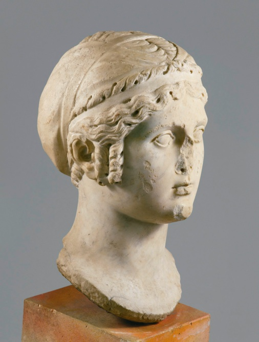 Sotheby's Lot 29. A MARBLE HEAD OF APHRODITE, ALSO KNOWN AS SAPPHO, ROMAN IMPERIAL, CIRCA LATE 1ST/EARLY 2ND CENTURY A.D. Height 13 3/4 in. 34.9 cm. Estimate: $40,000-60,000. Provenance Galerie de Bayser, 30, rue de Varenne, Paris acquired by the present owner from the above on June 17th, 1978