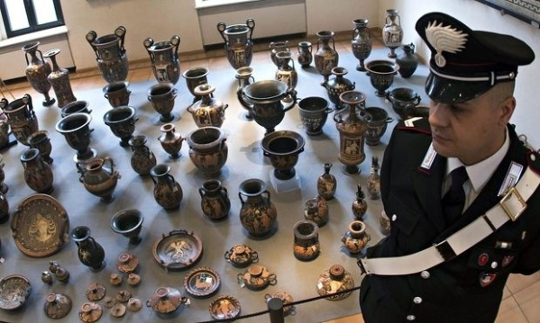A carabiniere guards the archeological treasures at the Terme di Diocleziano museum in Rome, Italy. Photograph: Claudio Peri/EPA