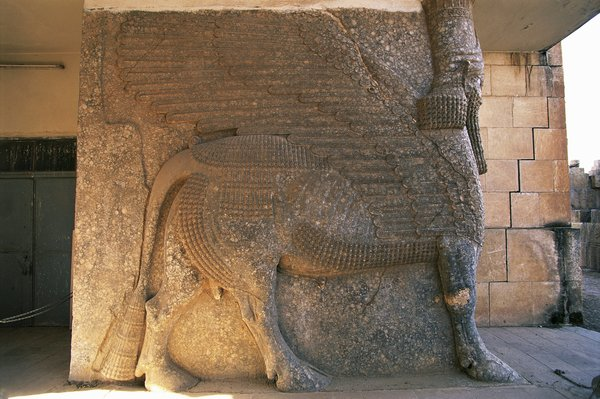 A relief of a mythological creature in the Palace of Ashurnasirpal II in Nimrud, Iraq. Militants used bulldozers and other vehicles to vandalize the site. Credit DeAgostini/Getty Images
