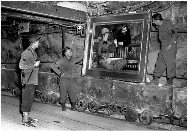 American soldiers look at artwork looted by the Nazis in World War II. Credit National Archives. Click on image to enlarge.