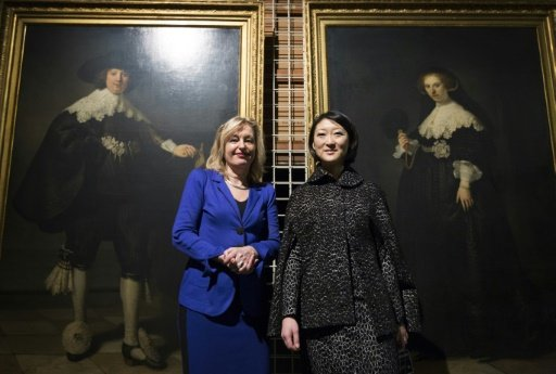 © ANP/AFP | Dutch Minister of Education Jet Bussemaker (L) and French Minister of Culture and Communication Fleur Pellerin pose in front of portraits of Maerten Soolmans and Oopjen Coppit, painted by Rembrandt van Rijn, at the Louvre in Paris on February 1, 2016